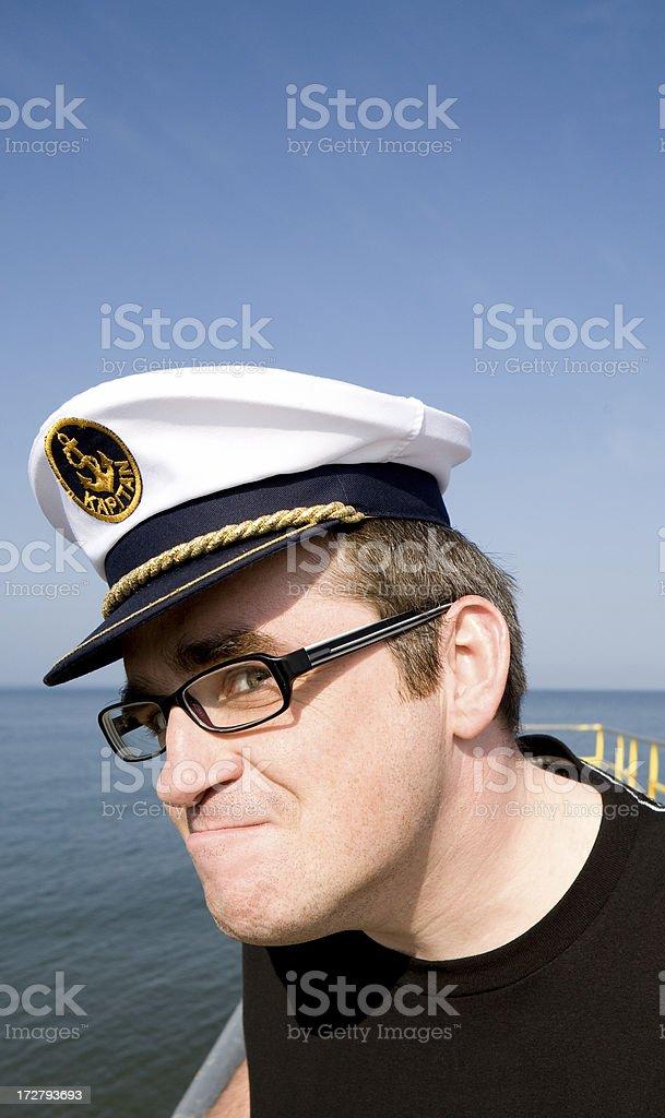 Man wearing sailor hat grimacing royalty-free stock photo