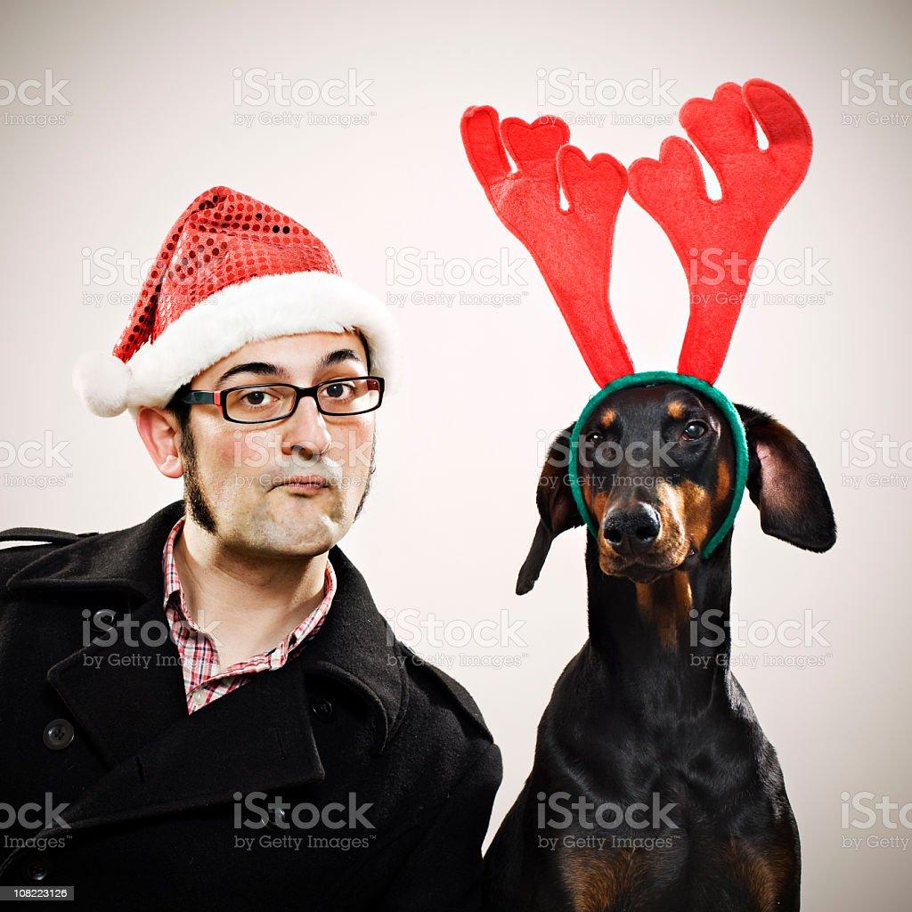 Man Wearing Santa Hat with Reindeer Dog royalty-free stock photo