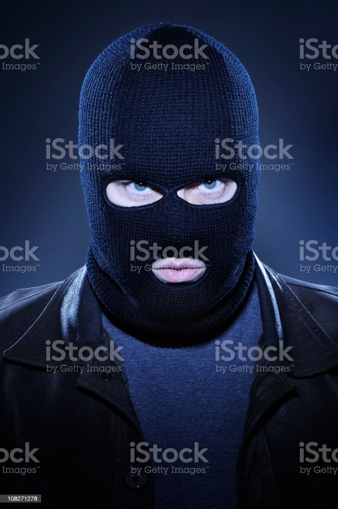 Man Wearing Ski Mask and Staring stock photo