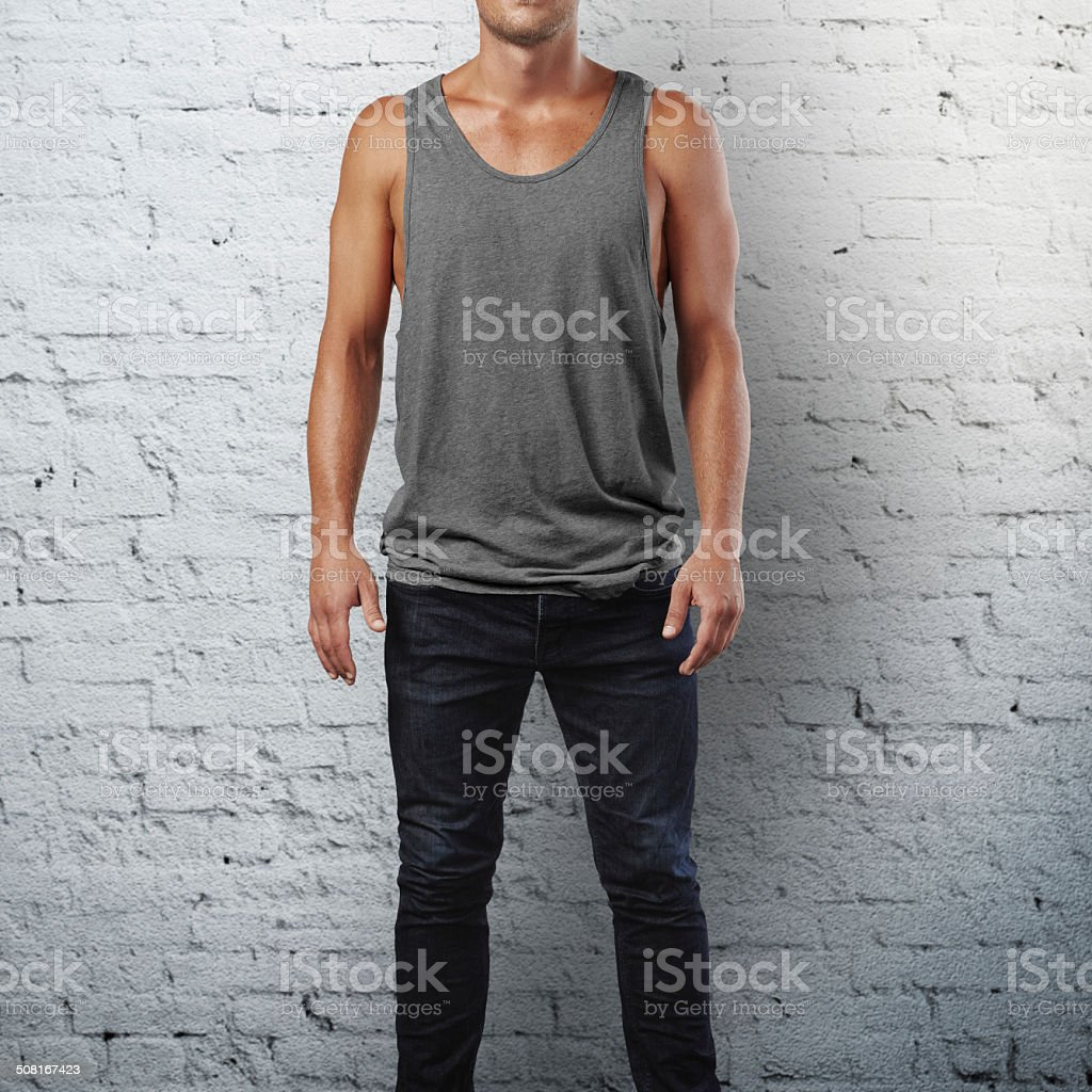Man wearing sleeveless shirt stock photo