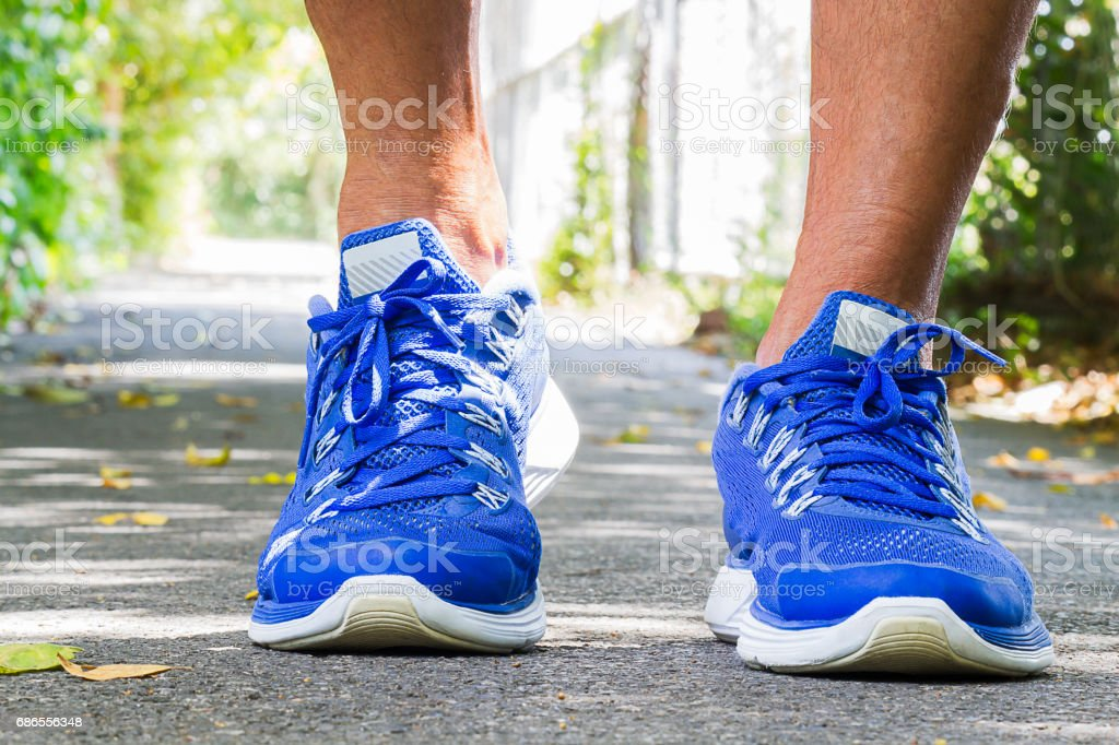 Man wearing sport shoes walking in the park, sport concept royalty free stockfoto