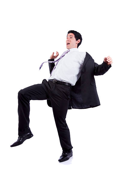 Man wearing suit and tie falling backwards stock photo