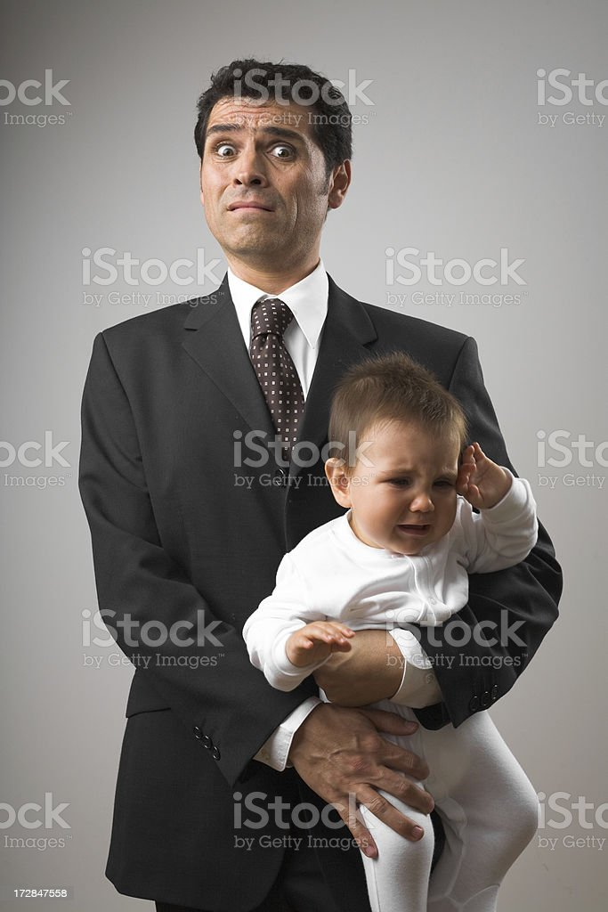 Man wearing suit holding a baby stock photo