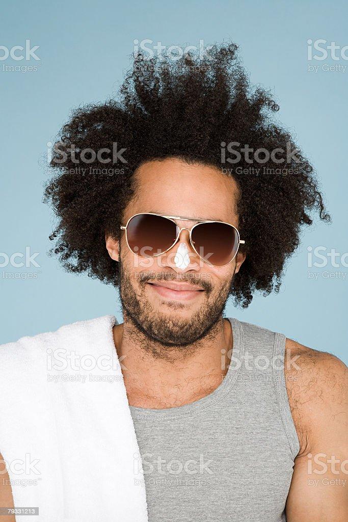 A man wearing suncream and sunglasses 免版稅 stock photo