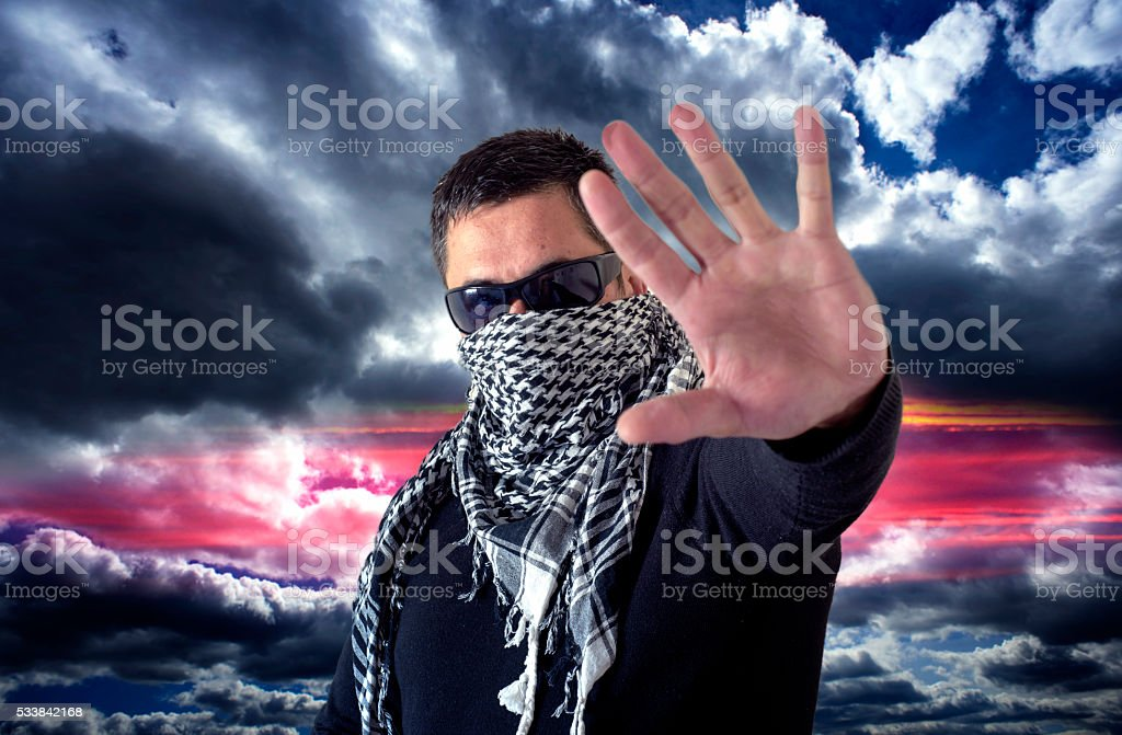 Man Wearing Sunglasses and a Keffiyeh Stop Sign stock photo
