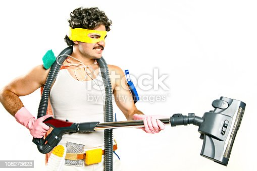 istock Man Wearing Superhero Mask Holding Vacuum and Cleaning Supplies 108273623