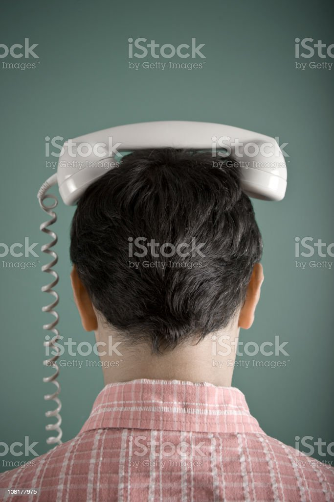 Man Wearing Telephone on Head royalty-free stock photo