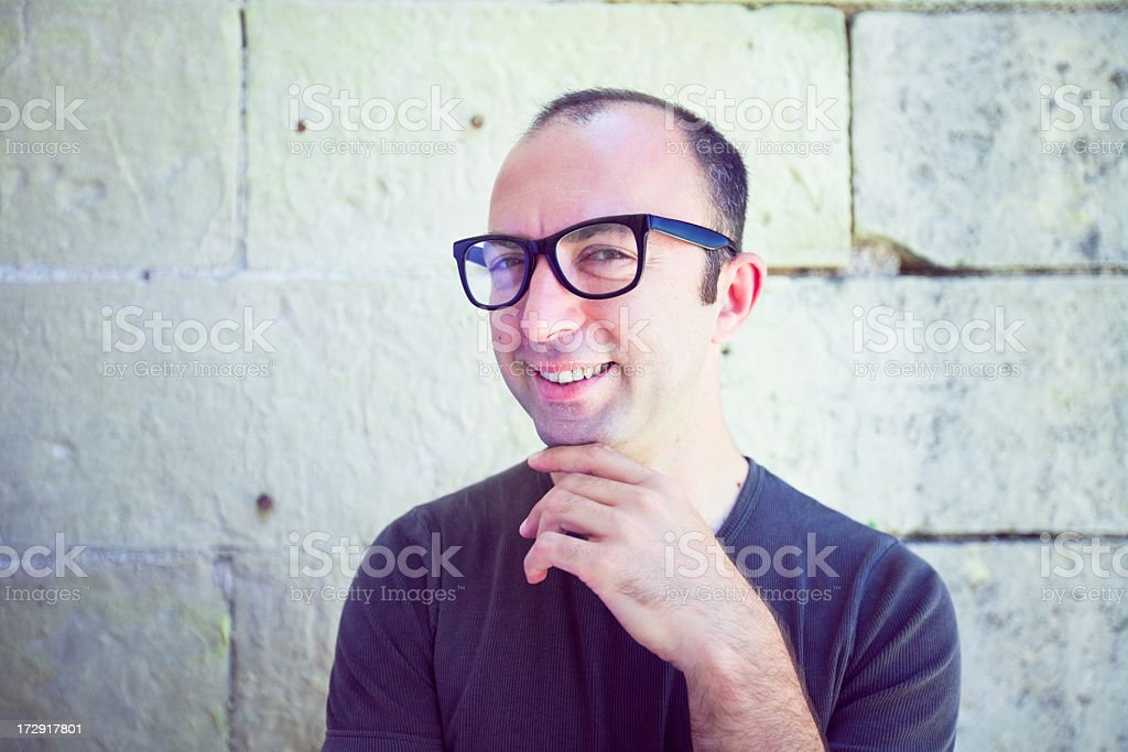 Man wearing thick black glasses smiling stock photo