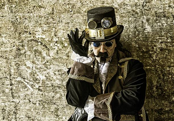 man wearing victorian/steampunk clothing against gold background - steampunk stock photos and pictures
