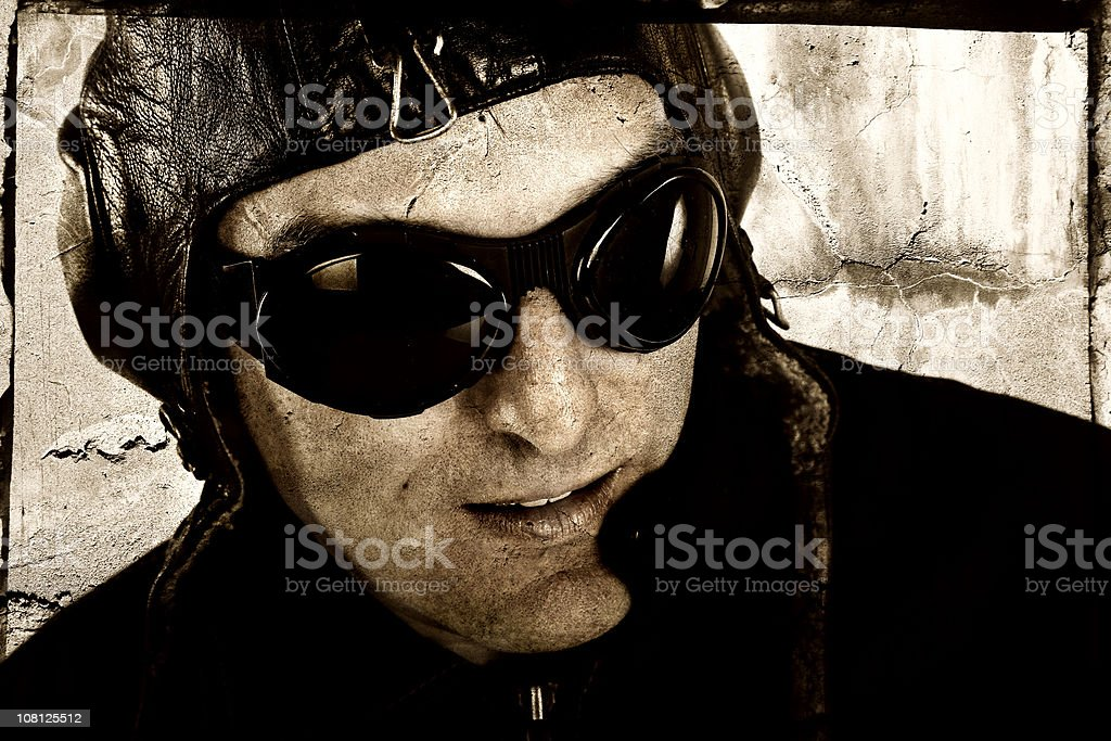 Man Wearing Vintage Aviator Hat and Flying Goggles royalty-free stock photo