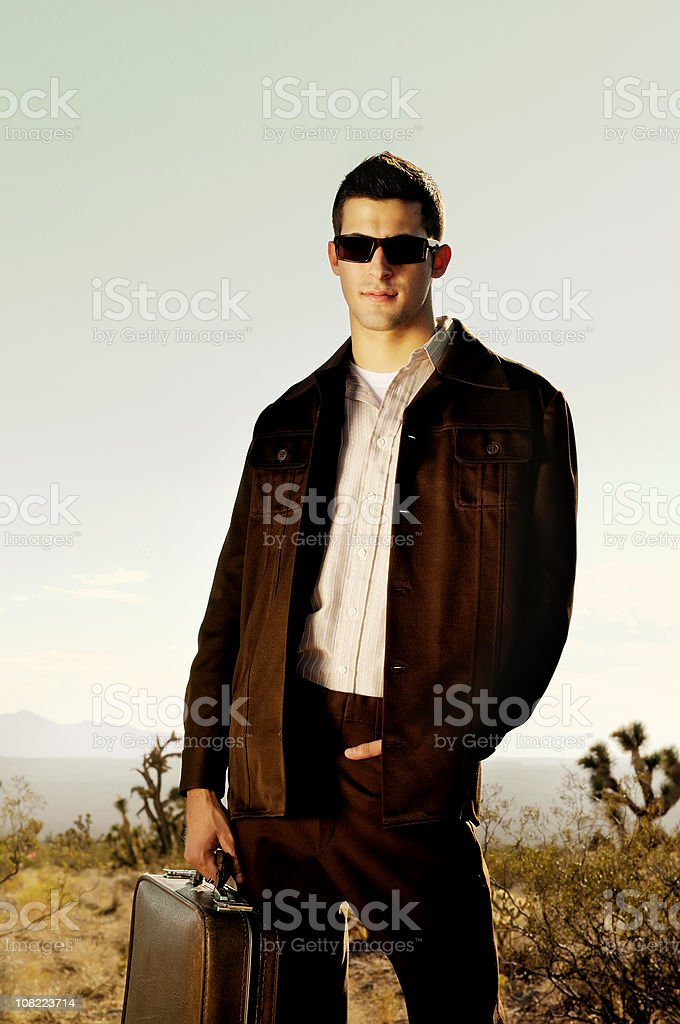 Man Wearing Vintage Suit and Holding Suitcase royalty-free stock photo