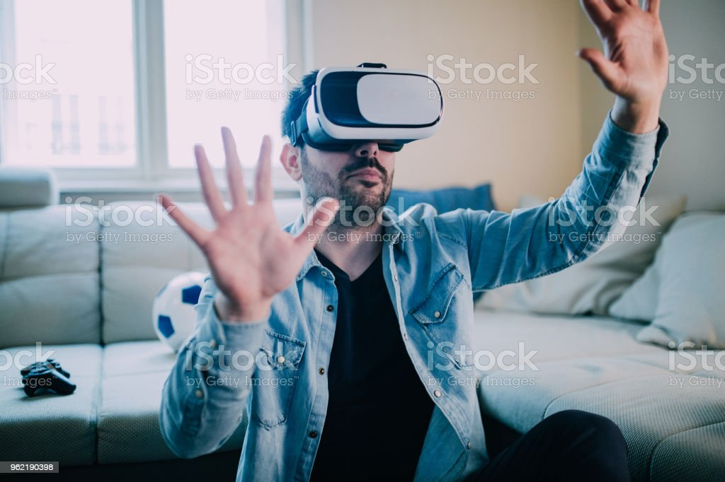 Man wearing virtual reality glasses stock photo