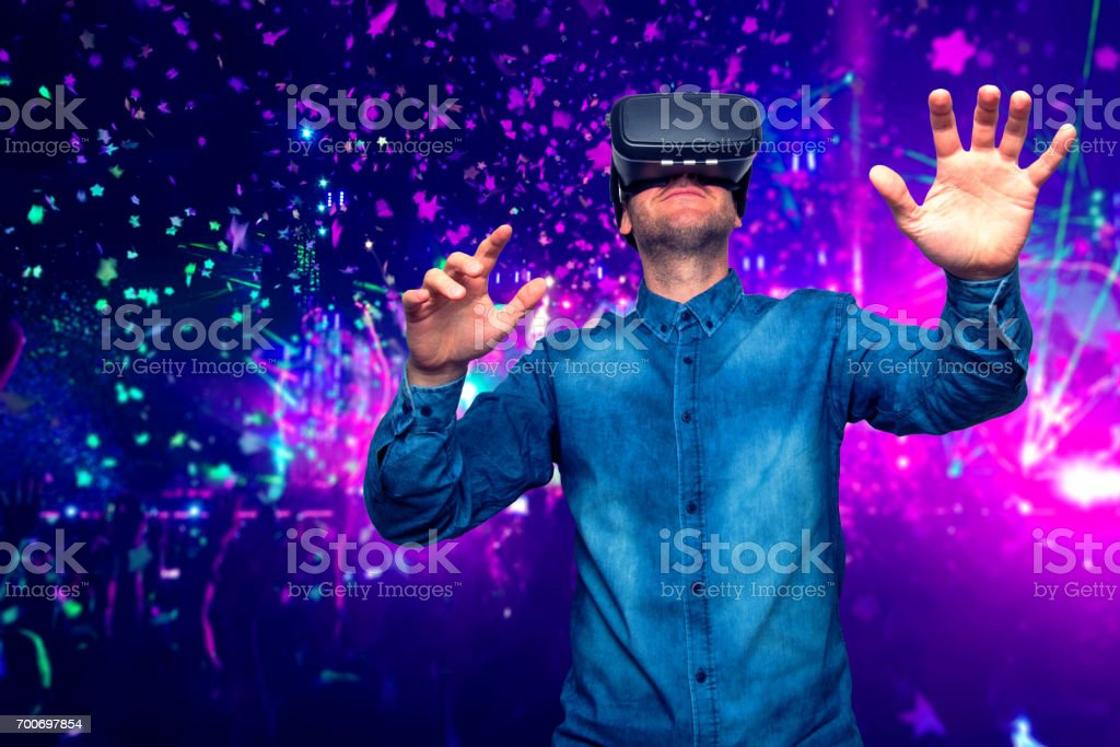 Man wearing virtual reality goggles. Concert background stock photo