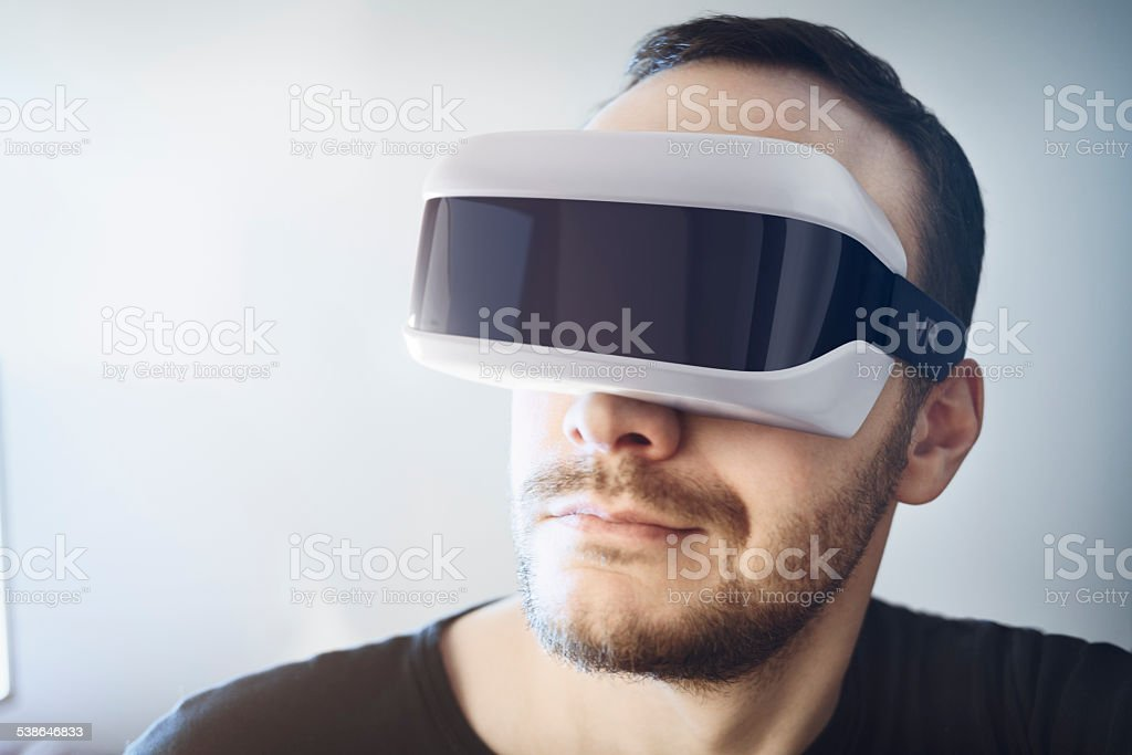 Man wearing virtual reality headset stock photo