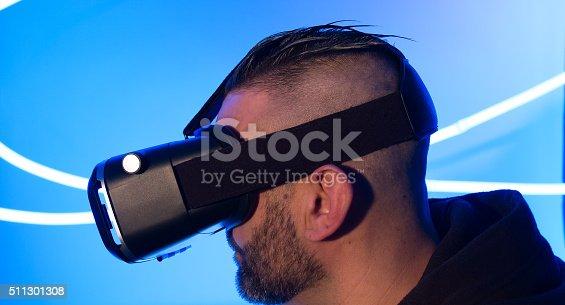 istock Man wearing vr virtual reality goggles 511301308