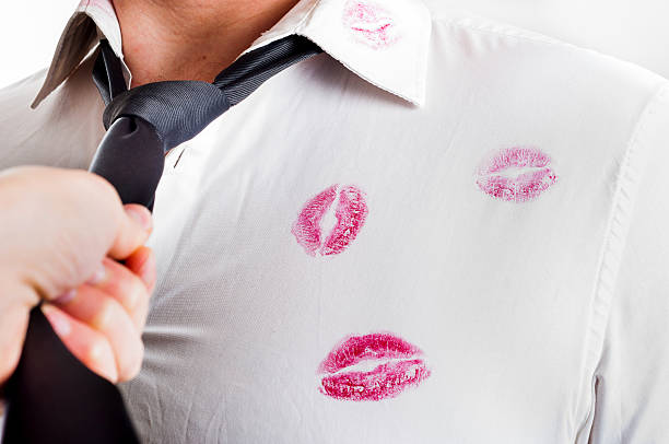 man wearing white shirt covered by red lipstick kisses - kissing on neck stock photos and pictures