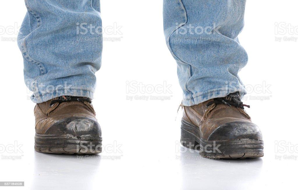 man wearing workboots stock photo