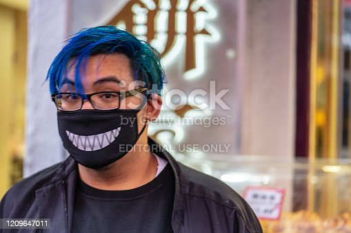 1202557009istockphoto A man wears a protective face mask in London 1209647011