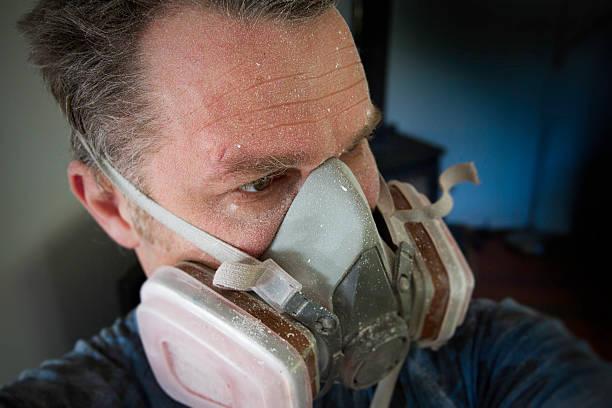 man wears a protective respirator - andningssystem bildbanksfoton och bilder