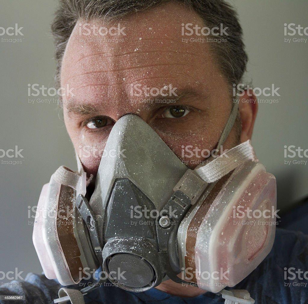 Man wears respirator stock photo