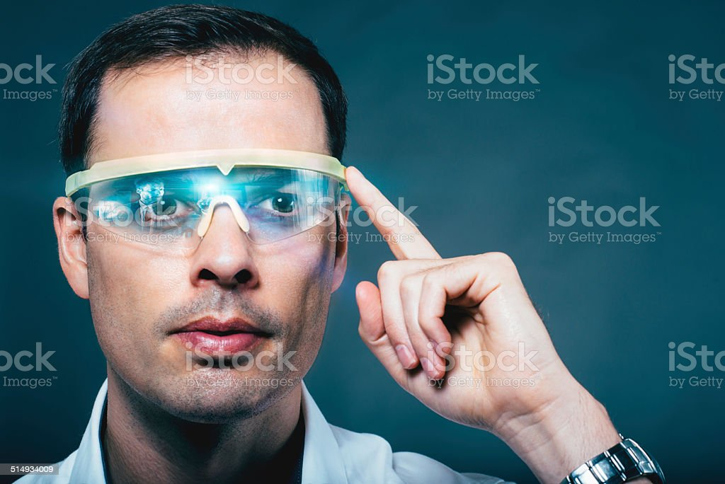 Man wears technology glasses with a visual screen stock photo