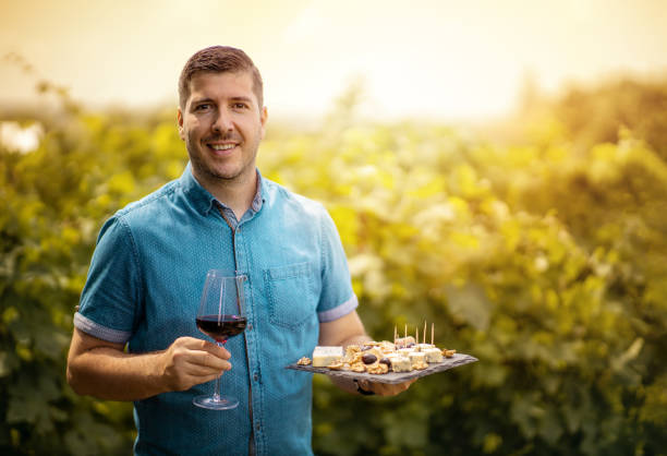 Man welcoming tourist at sunset in the winery stock photo