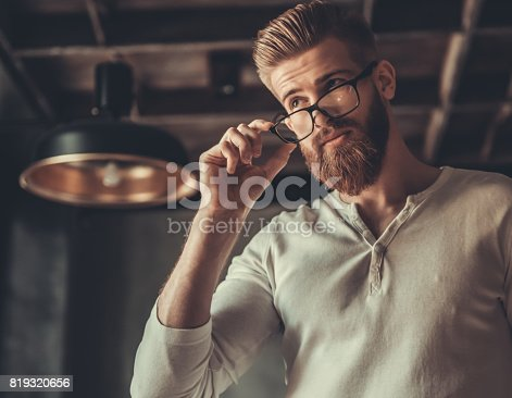 951331990 istock photo A man while working in an office 819320656
