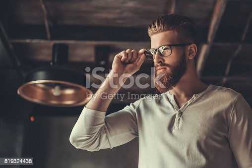 951331990 istock photo A man while working in an office 819324438