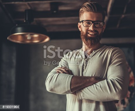 951331990 istock photo A man while working in an office 819331964