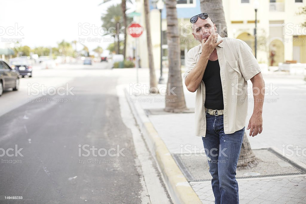 Man whistling for a cab stock photo