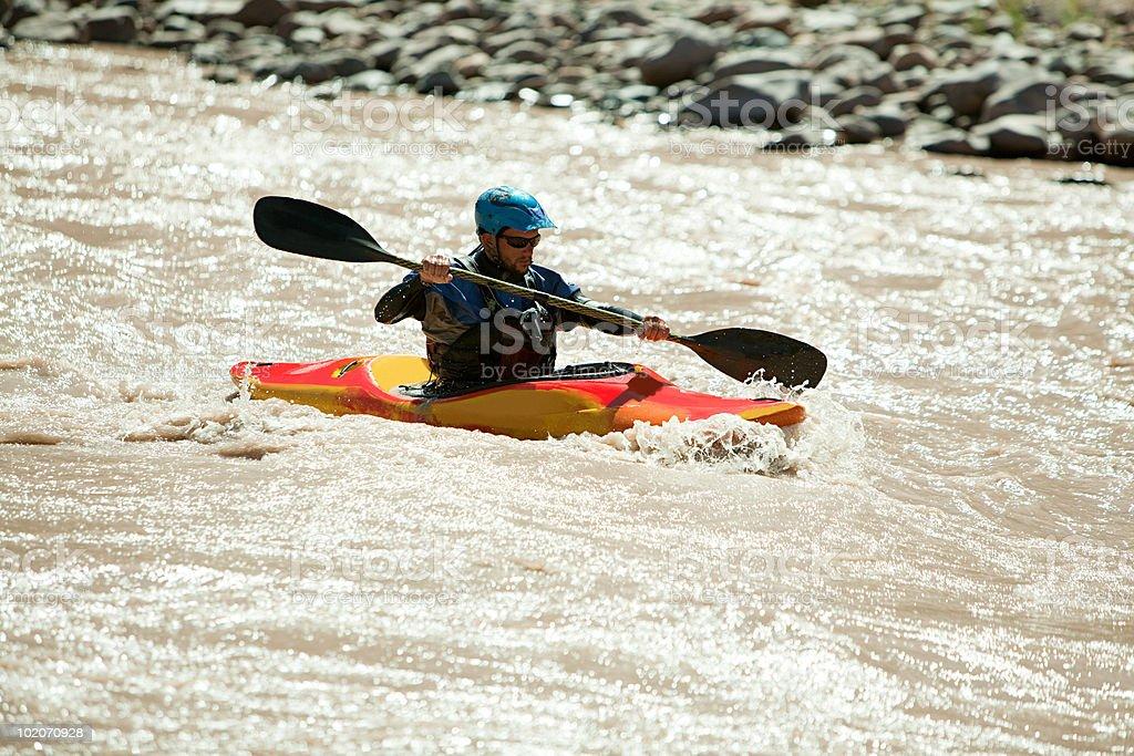 Man white water kayaking