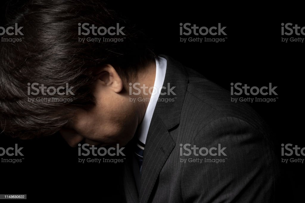 Man who apologizes with his head down