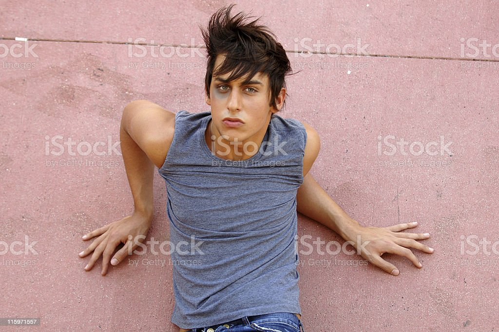 A man who has been beaten up lies in the floor royalty-free stock photo