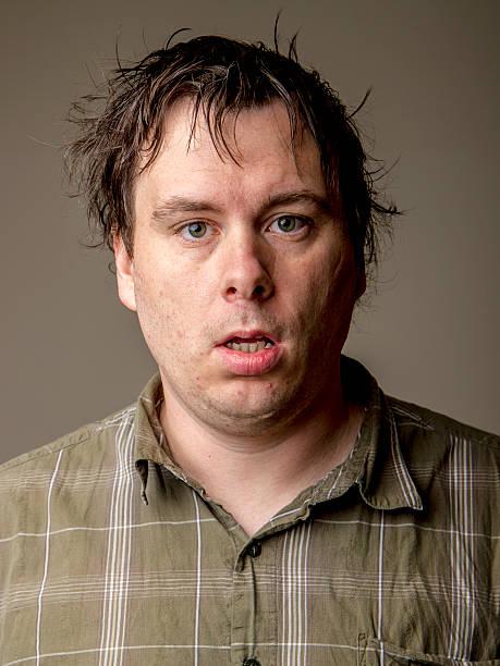 Man who looks like he just woke up stock photo