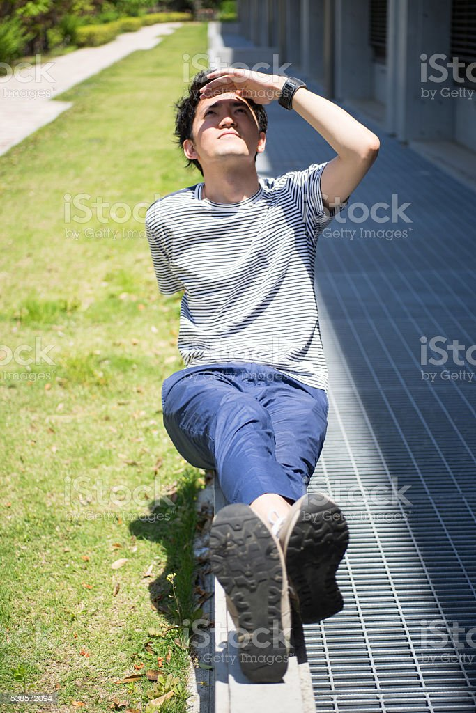 Man who looks up at the sky stock photo