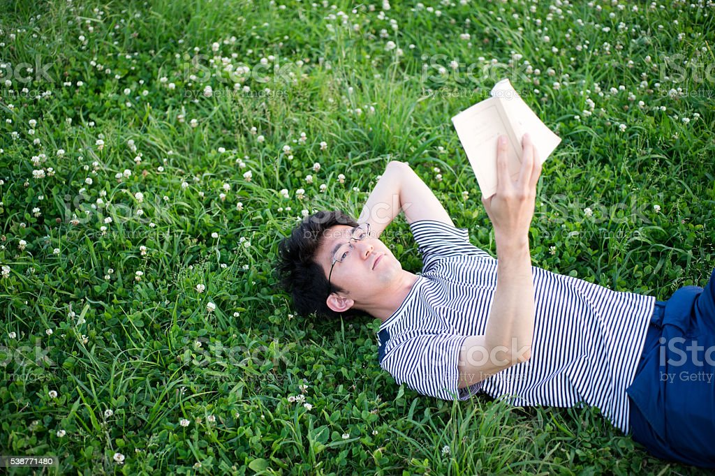 Man who reads on a lawn