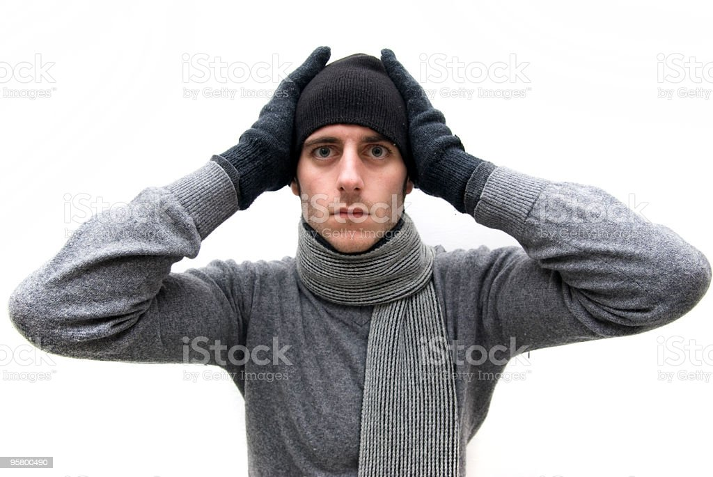 man who stop their ears to avoid hearing royalty-free stock photo