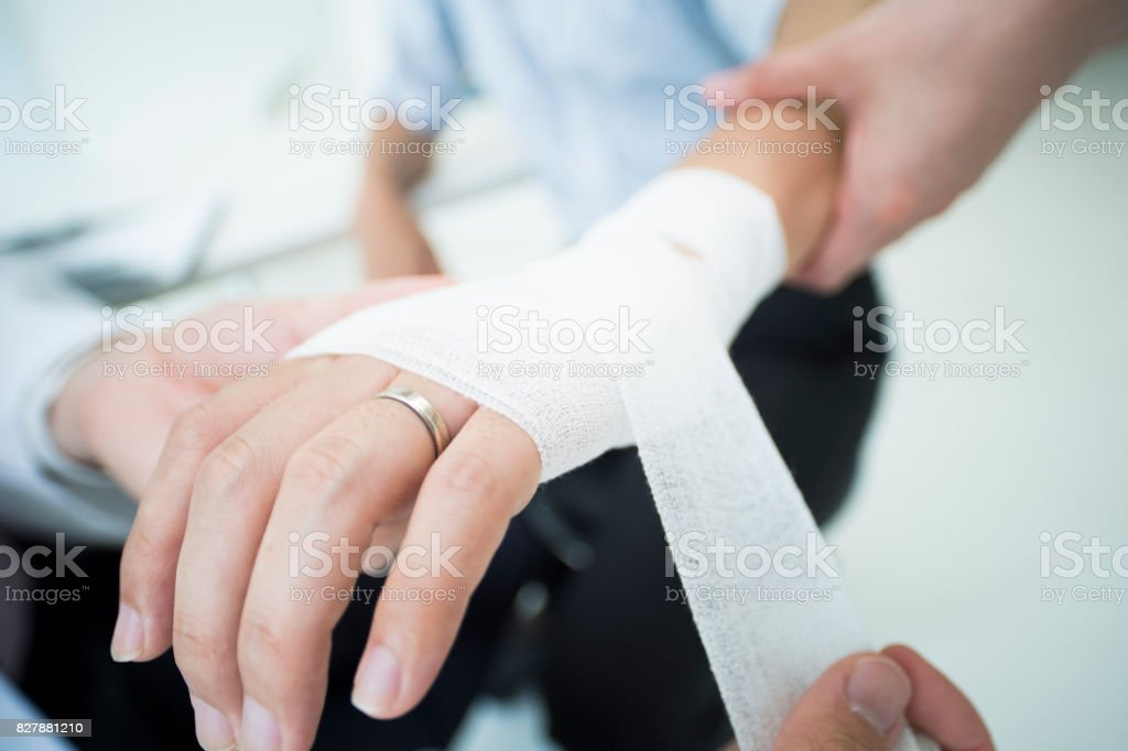 A man who wore a wedding ring got a doctor to receive an allowance for injury. stock photo