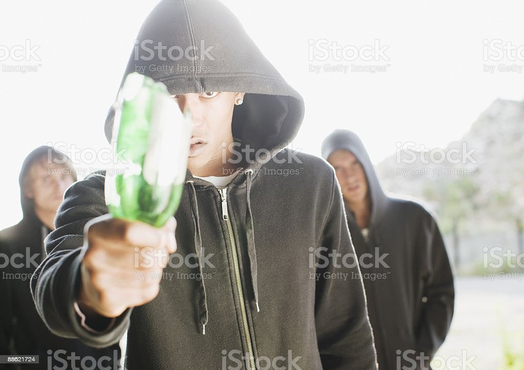 Man wielding broken bottle royalty-free stock photo