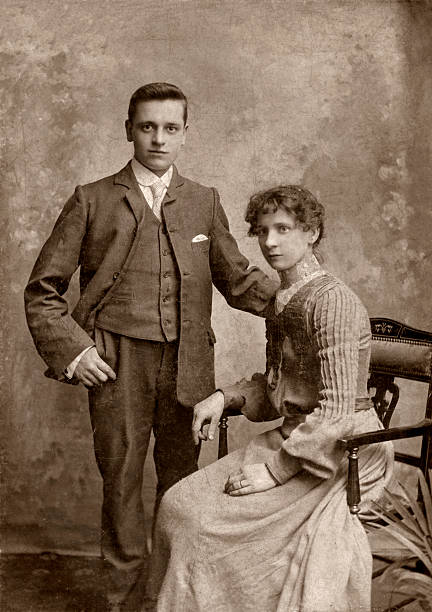 Man & Wife Wedding day portrait of a victorian man and his wife. edwardian style stock pictures, royalty-free photos & images