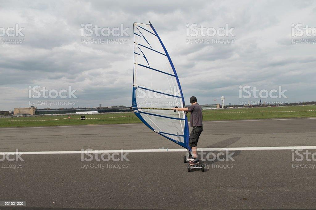 man windskating on the Tempelhof airport stock photo