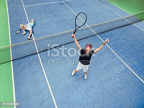 Man winning a tennis match