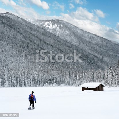 man hiking in winter mountains, square frame