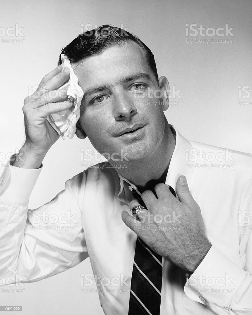 Man wiping forehead royalty-free stock photo