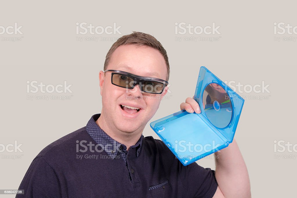 Man with 3D glasses and 3D blu-ray disc stock photo