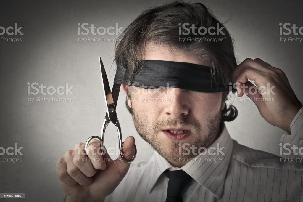 Man with a band on his eyes stock photo
