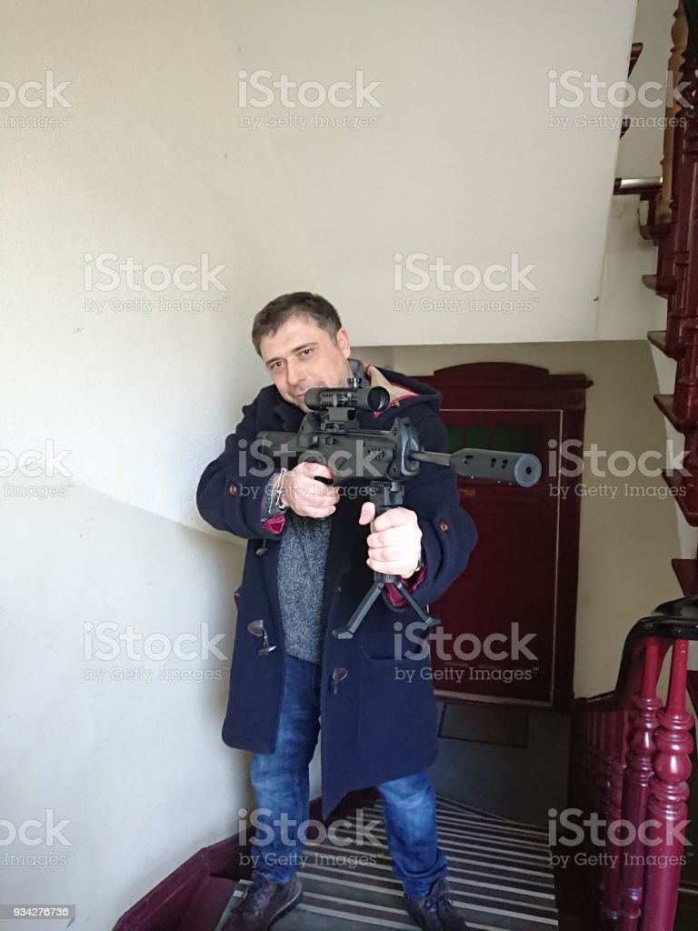 Man with a barrel rifle stock photo