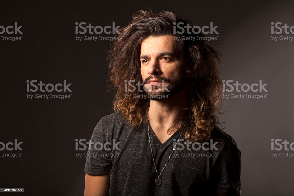 man with a beard and long hair stock photo