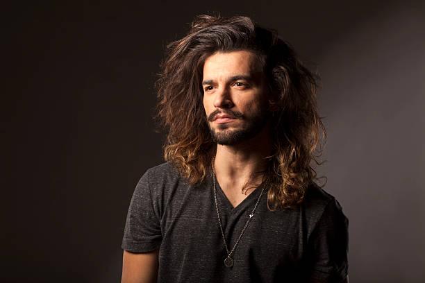 man with a beard and long hair stock photo