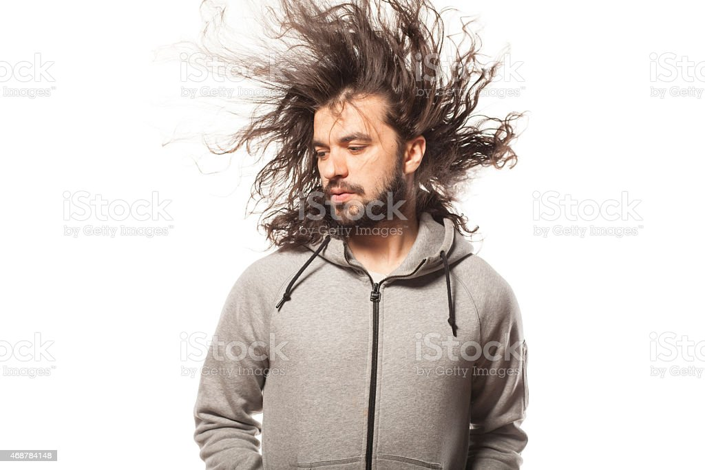 man with a beard and windy hair stock photo
